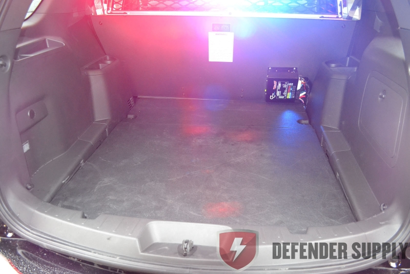 Expanded mesh cargo barrier for a 2013 Ford Interceptor SUV